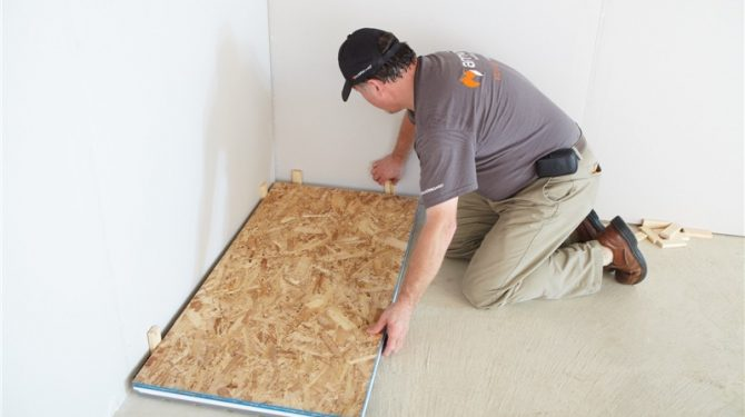 "Step 1: Place ½"" spacers, starting in one corner. Align the first Amdry panel against the spacer boards."